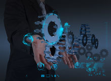 Businessman hand working with cog gear to success. As teamwork concept stock photo