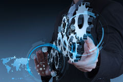 Businessman hand working with coggear to success. As concept royalty free stock photos