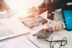 Businessman hand working with finances about cost and calculater Royalty Free Stock Image