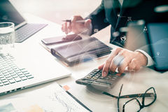 Businessman hand working with finances about cost and calculater Royalty Free Stock Photo