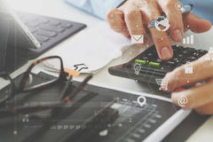 Businessman hand working with finances about cost and calculator. Close up of businessman hand working with finances about cost and calculator and latop with Stock Photos