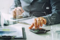 Businessman hand working with finances about cost and calculator Royalty Free Stock Photo
