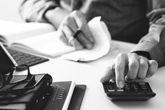 Businessman hand working with finances about cost and calculator Stock Image