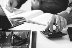 Businessman hand working with finances about cost and calculator Stock Photography