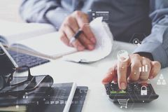 Businessman hand working with finances about cost and calculator Royalty Free Stock Image