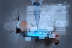 Businessman hand working with modern technology Stock Images