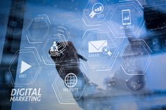 Businessman hand working with modern technology and digital laye. Digital marketing media (website ad, email, social network, SEO, video, mobile app) in virtual Royalty Free Stock Images
