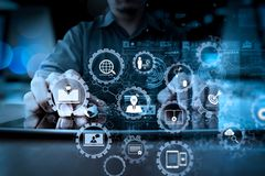 Businessman hand working with modern technology and digital laye. E-learning with connected gear cogs connected diagram virtual dashboard.businessman hand Stock Photography
