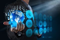 Businessman hand working with new modern computer show the earth Royalty Free Stock Image