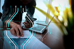 Businessman hand working with new modern computer and smart phon. Business data analytics process management diagram.businessman hand working with new modern Stock Image