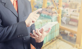 Businessman hand working and smart phone and laptop on Industrial Container Cargo freight ship background (Elements of this image stock photography