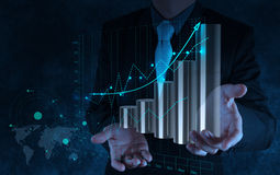 Businessman hand working with virtual chart business on touch sc Stock Photos