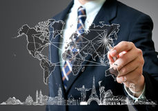 Businessman hand write Travel concept. In the world Stock Image