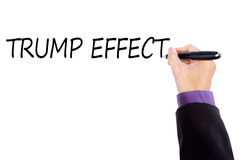 Businessman hand writes Trump Effect Royalty Free Stock Photography
