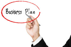 Businessman hand writing business plan, isolated on white background Royalty Free Stock Photo