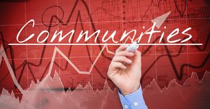Businessman hand writing COMMUNITIES  on the screen. Stock market, red background. Digital composite of Businessman hand writing COMMUNITIES  on the screen Royalty Free Stock Image