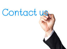 Businessman hand writing contact us Stock Photos