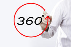 Businessman hand writing. `360 degrees goals`  with marker on transparent board. Business, internet, technology concept Stock Photography
