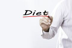 Businessman hand writing diet with marker, Business concep Royalty Free Stock Photo