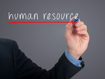 Businessman hand writing Human Resource in the air stock images
