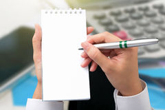 Businessman hand writing a note in blank. Stock Photography
