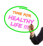 Businessman hand writing text time for healthy life Royalty Free Stock Photo