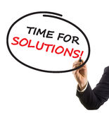 Businessman hand writing text time for solutions Royalty Free Stock Photos