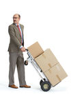 Businessman and handcart with a load Stock Photos