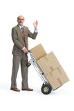 Businessman and handcart. Ok Royalty Free Stock Images