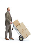 Businessman and handcart Stock Photo