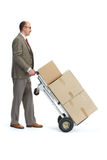 Businessman with a handcart Stock Image