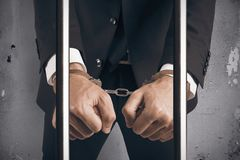 Businessman handcuffed. Concept of handcuffed businessman in jail Stock Photography