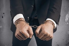 Businessman handcuffed. Concept of handcuffed businessman in jail Stock Photos
