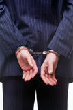 Businessman in handcuffs. Rear view of a businessman in handcuffs Royalty Free Stock Photography