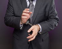 Businessman in handcuffs Royalty Free Stock Photos
