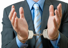 Businessman in handcuffs Stock Images