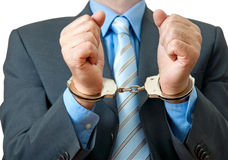 Businessman in handcuffs Royalty Free Stock Image