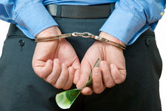 Businessman in handcuffs Royalty Free Stock Images