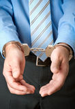Businessman in handcuffs. White collar criminal under arrest Royalty Free Stock Photos