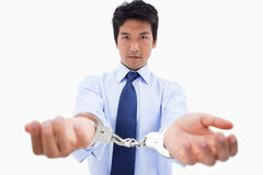 Businessman with handcuffs Royalty Free Stock Images