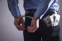 Businessman in handcuffs. Business Crime royalty free stock photo