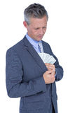 businessman in handcuffs holding bribe Royalty Free Stock Photo