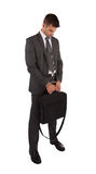 Businessman in handcuffs holding briefcase Royalty Free Stock Photo