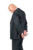 Businessman in handcuffs Stock Image
