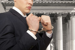 Businessman in handcuffs Stock Photo