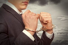 Businessman in handcuffs Stock Photography