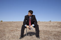 Businessman with a handgun Royalty Free Stock Photography