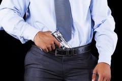 Businessman with a handgun Royalty Free Stock Photos