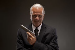 Businessman with handgun Royalty Free Stock Image