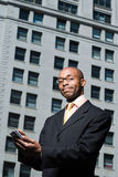 Businessman with handheld computer Stock Photos
